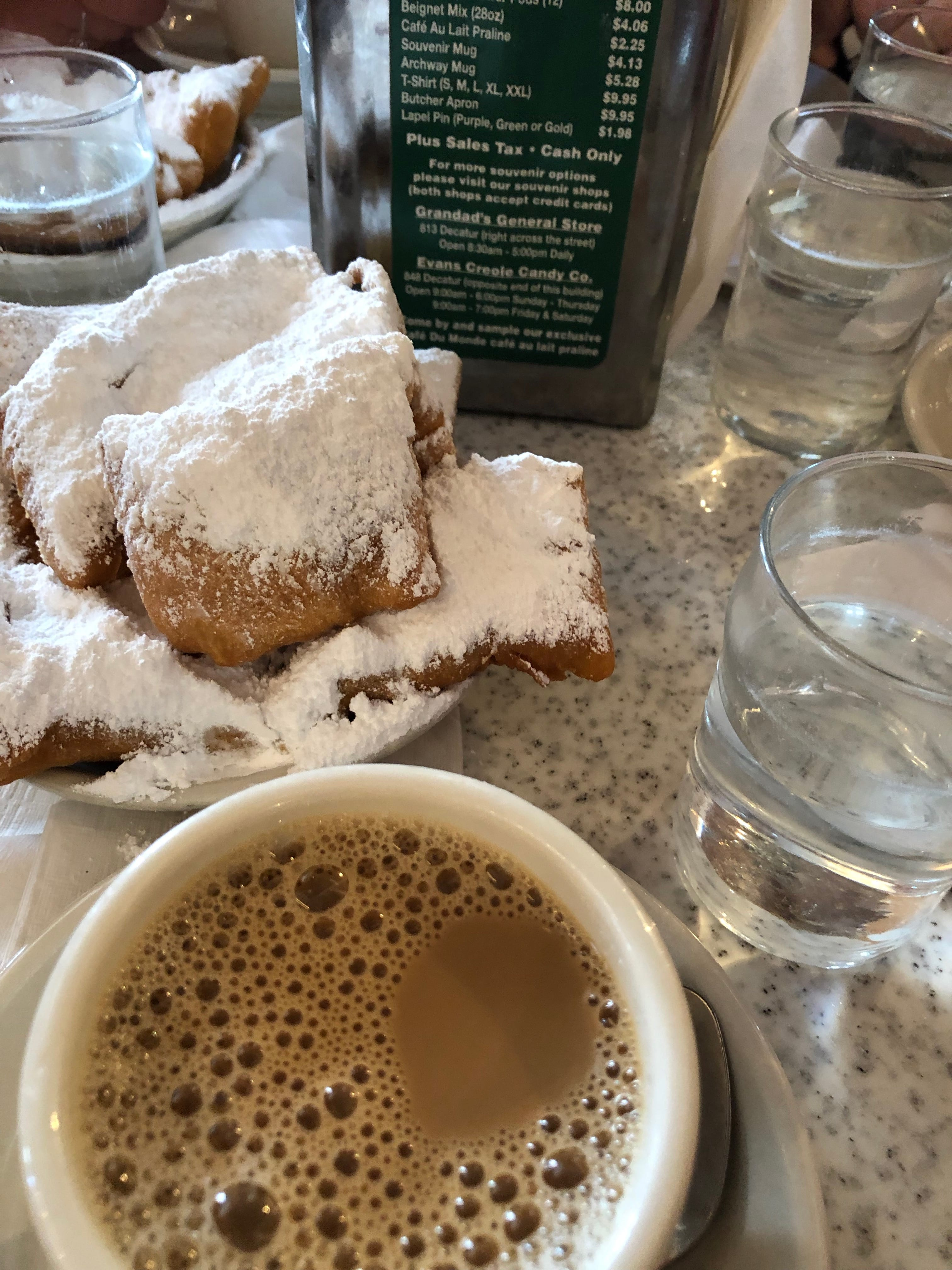 Beignets and café au lait at Café Du Monde